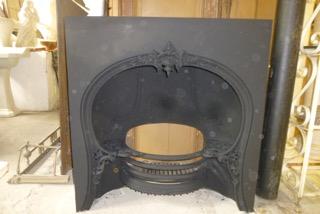 Victorian cast iron horseshoe grate