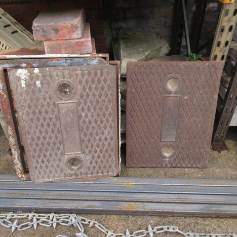Pair of Cast Iron Drain Covers