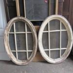 Pair oval pine windows