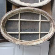 Pair oval pine windows